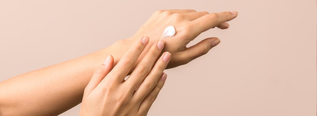 hand moisturising with cosmetic cream