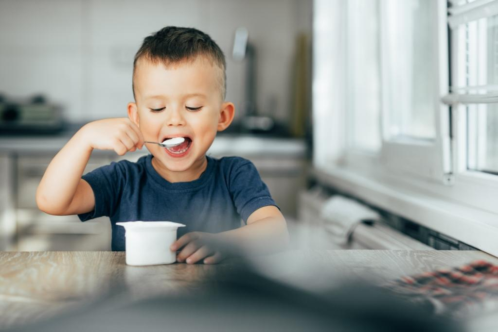 A boy eating a Dairy Product