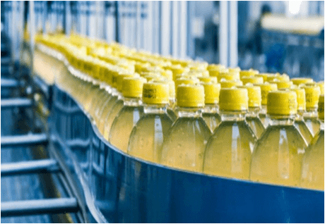 Alignment of PET bottles on a conveyor before the Application of a Heat-shrink Sleeve Label