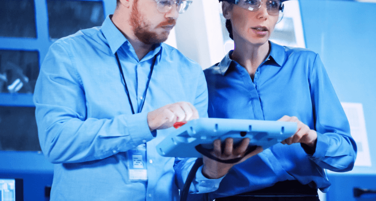 Experts monitor and control an industrial production batch with an interactive touch screen tablet