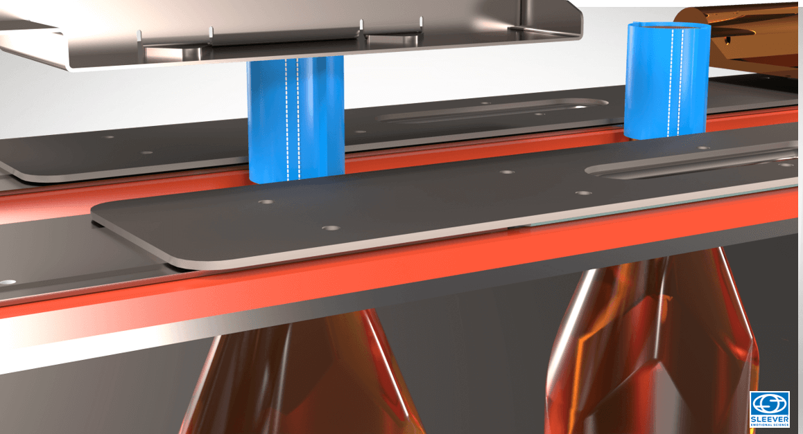 The precision of the placement of the Tamper Evident Sleeve is ensured by positioning belts